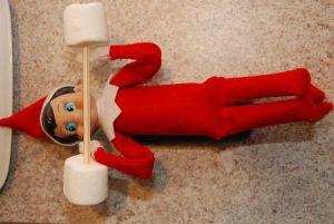Little elf lifting heavy weights....marshmallows on toothpick!