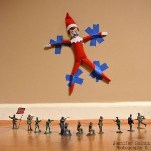 Your elf got attacked by the army men....obviously this is a better choice for boys...but if your girl has army men - I like her!