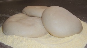 Pizza Dough. Make it from scratch and freeze it. Then make it fun night for the family and pizza night. ;)  You can even make these in personal pizza sizes.